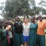 Kimberly De Vera with some of the Ugandan students